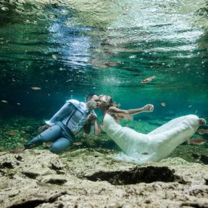 trash the dress in cenotes cancun wedding photography