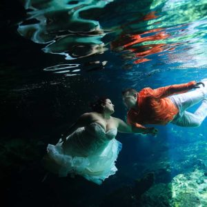 trash the dress in cenotes riviera maya underwater wedding photography